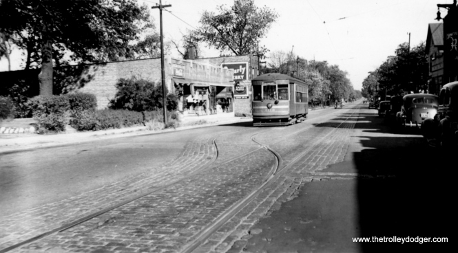 "CSL 3113. M. E. writes: ""As for Beverly Bakery: On 103rd, south side, just west of Vincennes was a bus barn, then the Beverly Bank. So it's logical to assume that Beverly stretched east of Vincennes, at least as far as the bakery. However, the Rock Island commuter station at 103rd and Vincennes is called Washington Heights."" Chuck Amstein: ""103rd and just west of Elizabeth St., looking ENE. The 2 buildings just left of #3113 are still there. They can also be seen in the background in misc832. The track layout agrees with the CSL 1941 track map, conveniently included in ""Chicago's PCC Streetcars: The Rest of the Story""."""