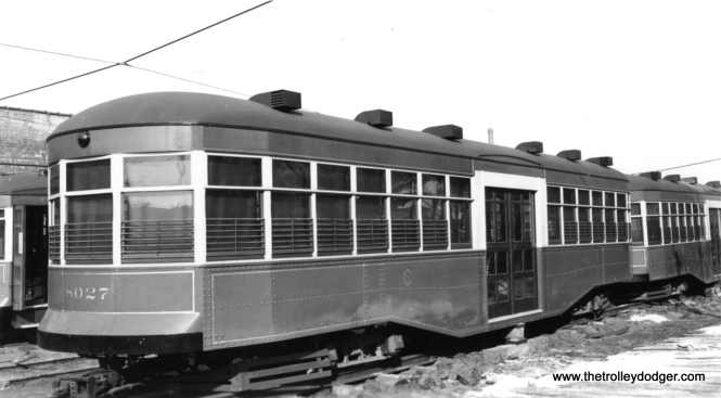 "CSL trailer 8027, built by the Surface Lines in 1921 during a time when ridership was greatly increasing. Trailers were no longer needed in the 1930s due to the Depression, and while they were considered for use during World War II they ended up as storage sheds such as this one. According to George Trapp, this photo was taken at the Devon Depot. Andre Kristopans: ""As for the trailers, all were sheds by 1930 or so. Some were fixed up to go back into service about 1942, but never did, and these were the ones scrapped in 1944-45."""