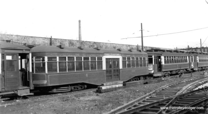 "George Trapp: ""CSL Trailer 8050 is also at Devon Depot, Note new track in foreground, car is sandwiched between a Big Pullman and a 169 class car."" The trailer was built in 1921."