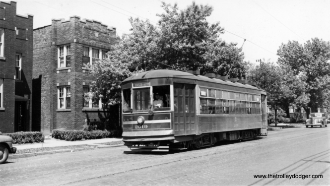 "CSL 2910 heading west (signed for Austin, the city limits) in the 1940s. George Trapp: ""CSL 2910 is on West Division line, Destination reads Division-Austin, this type of car a regular on this route."" From our comments section: ""CSL 2910 is signed DIVISION-AUSTIN. Short line operated on Division between Grand and Austin until it was through routed by bus to California until it was further through routed to downtown."" ""CSL 2910 heading west (signed for Austin, the city limits) possibly Division / Austin … location is possibly on Division just east of Grand ave."" Andre Kristopans: ""2910 is most likely on West Division St, California to Austin, as it is a small one-man car."" Mike Franklin: ""CSL 2910 heading west and the two flats are located on the 5000 block of Division."""
