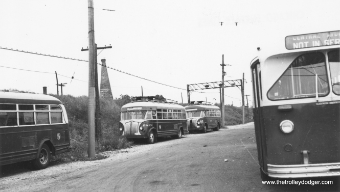"CSL had an open-air trolleybus yard at Central and Avondale, adjacent to the Chicago & North Western. The Kennedy expressway now occupies this location. (Railway Negative Exchange Photo) Ray Piesciuk: ""The open air TB yard at Central-Avondale shows two buses with poles that are not trolley buses. They are work motor buses BA-106 & BA-115 outfitted with sleet scraping poles."" Another reader writes: ""Note the ""Marmon-Herrington"" builder's plate on the front of the bus. When the buses were retired, there were no such builder's plates to be found under the advertising holders that had existed at that location for most of the lives of the coaches. """