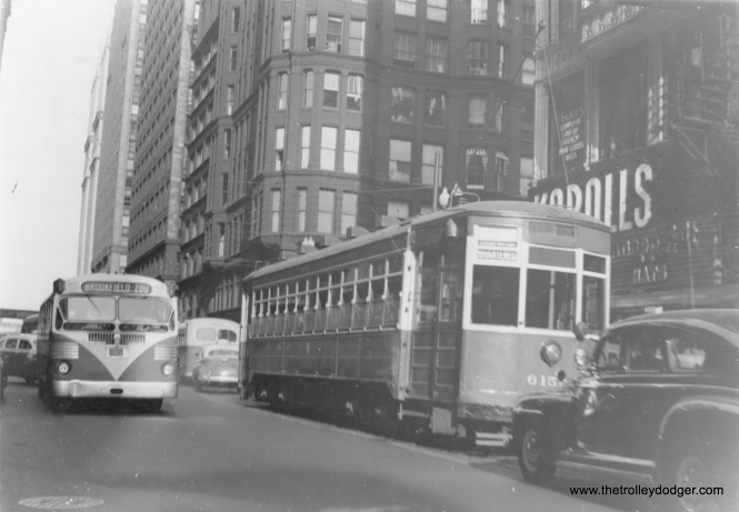 "CSL 6153 on a charter, eastbound at Washington and State. Meanwhile, a suburban bus bound for the Brookfield Zoo approaches. (Edward Frank, Jr. Photo) Andre Kristopans: ""The Brookfield Zoo bus is Bluebird Coach Lines. Route was from downtown out Randolph, Ogden, 26th Desplaines, with most trips continuing out 31st, LaGrange, Ogden to Aurora."""