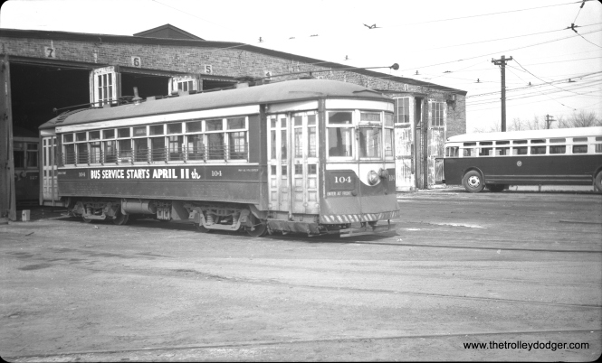 C&WT 104 at the Harlem and Cermak car barn on April 3, 1948, less than two before the end of streetcar service. One of the replacement buses is at right. (C. Edward Hedstrom Photo)