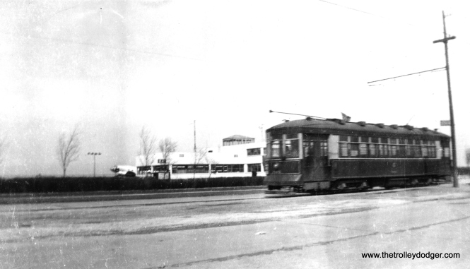 CSL modernized small Pullman 804 on south Cicero Avenue near Midway Airport. (Railway Negative Exchange Photo)