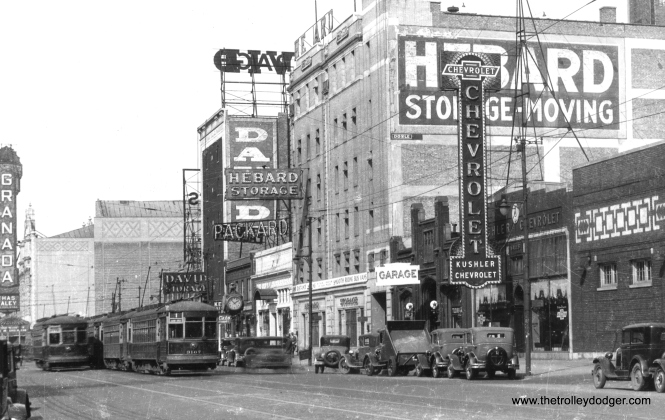 "CSL 3167 on Broadway at Sheridan. The old Granada Theatre, one of Chicago's lost movie palaces, is visible at rear. It was located at 6427 North Sheridan Road. (Railway Negative Exchange Photo) George Trapp adds: ""CSL #3167 is on Broadway between Rosemont and Devon-Sheridan, photo dates to around 1930. Note that car 3167 is the last car in a line of six 169 class cars as is the southbound Broadway car. These cars ran on Broadway and it's variants from 1923 until early 1948. Building at far right next to Kushler Chevrolet is the Rosemont Garage of the Chicago Motor Coach Company."""
