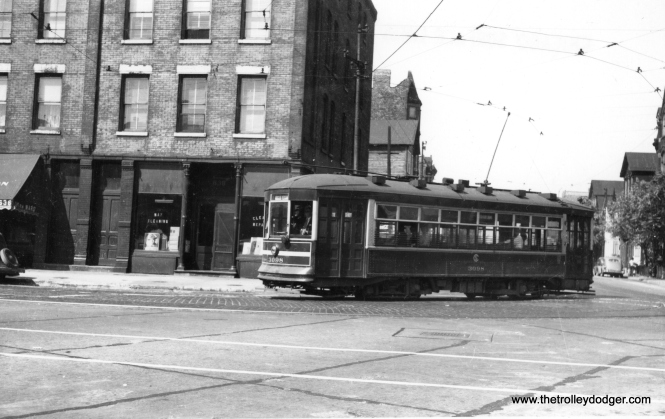 "Andre Kristopans: ""3098 SB turning off Erie into Racine."" (Railway Negative Exchange Photo)"