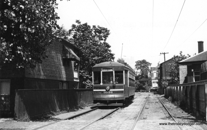 3096 signed for Morgan and Pershing, heads through some backyard private right-of-way. (Railway Negative Exchange Photo)