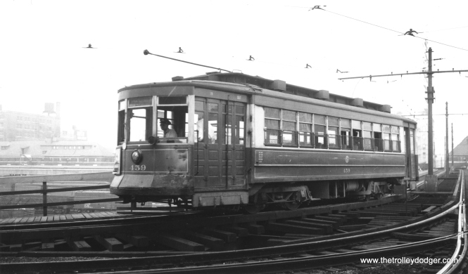 CSL 459 heading towards Soldier Field and the Field Museum of Natural History, crossing over the Illinois Central right-of-way. (Railway Negative Exchange Photo)