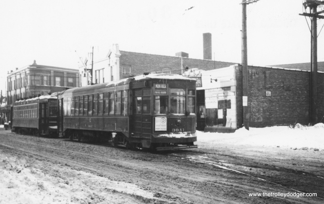 "CSL 3041 on Montrose in winter. Jim Huffman writes, ""Photo #936 shows two Montrose cars, waiting their time, about to go EB at Milwaukee Av. Note that the 1st car is a two-man car & the following car is a one-man car. On Lawrence Av after it went to one-man cars, on certain nights when the Aragon ballroom let out, two-man cars would be used at that time for the crowds."" (Railway Negative Exchange Photo) Streetcar service on Montrose ended on 7/29/46. The entire route was converted to trolley buses as of 4/19/48, which continued to 1973."