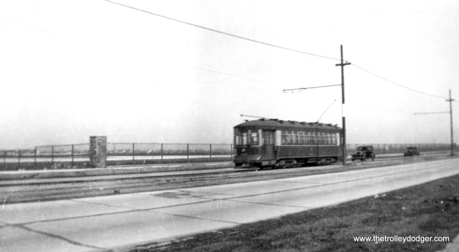 CSL modernized small Pullman 804 on south Cicero Avenue, near Midway Airport (which may have been called Chicago Municipal Airport when this picture was taken). (Railway Negative Exchange Photo)