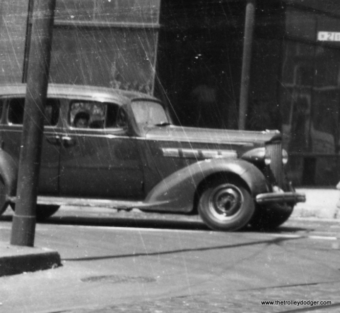 Close-up of the Packard. The trim design on the side of the engine compartment makes this a 1938 model. (Railway Negative Exchange Photo)