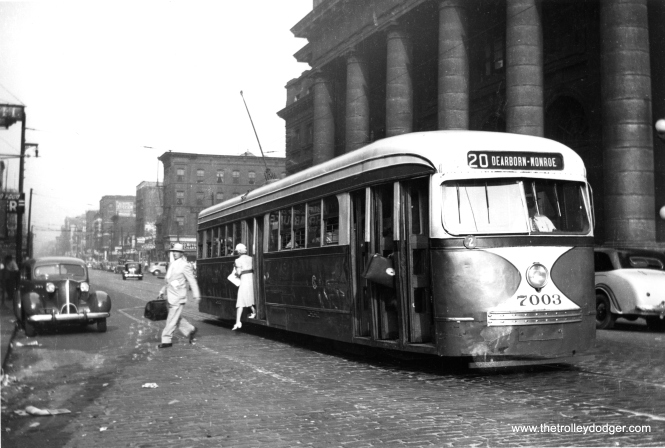 CSL 7003 lets passengers off in front of the old Chicago & North Western Station on Madison just west of the Loop. The late 1930s Packard at left helps date the picture.