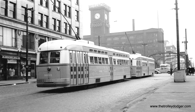 "CSL 4081 and another PCC are northbound on Clark at Wacker Drive, June 13, 1947. (J. William Vigrass Collection) On the back of the photo it says the second car is 7174, but George Trapp counters, ""The St. Louis built car cannot be 7174 based on the date, car 7174 being delivered 2/25/48. Note the car has a CSL logo and also has its rear marker and stop lights mounted on tubes, a spotting feature of the first 90 St. Louis Post War PCC's. It looks to me like the car is either 7071 or 7074."""