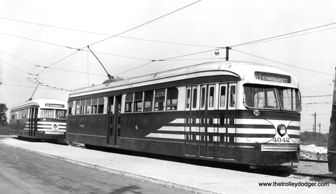 "CSL prewar cars 4042 and 7029, in ""tiger stripes,"" are at the loop at 63rd Place and Narragansett, western terminal of the 63rd Street line."