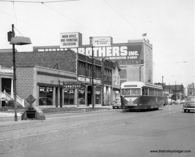 "CTA 4009 is on route 4 - Cottage Grove, circa 1952-55. Patrick writes, ""Photo 981 is in the 6700 block of (south) Cottage Grove, looking north. The one story Michael Dunn building still exists, as does the biggest building (now a self storage facility). This is across the street from Oak Woods Cemetery."""