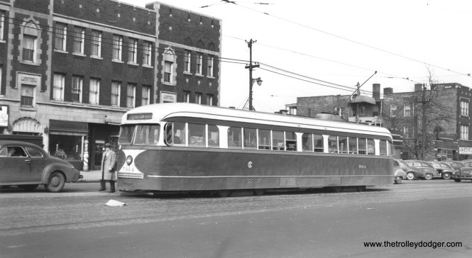 "CSL 7014 is westbound on the wider, outer end of Madison Street in this 1940s view. The auto at left is a type referred to as a ""business coupe,"" a two-door car with a small back seat and a large trunk-- the type of car favored by salesmen of the 1940s. (Joe L. Diaz Photo)"