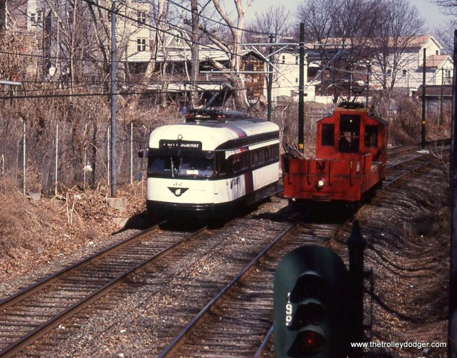 PCC 12 and motor flat 5223 meet at Davenport Avenue.