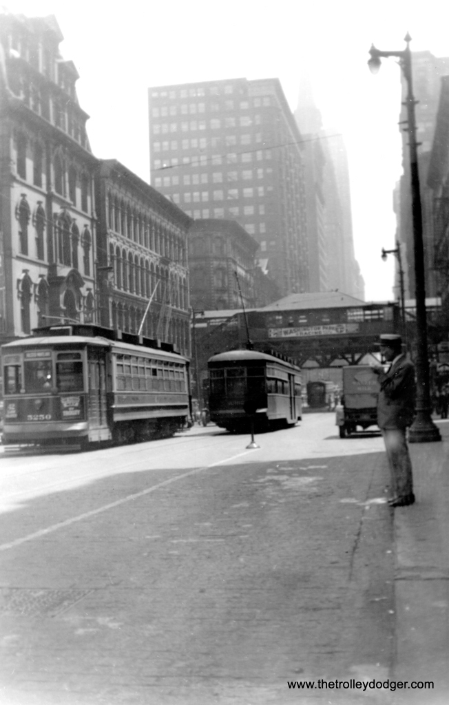 "A southbound Sedan has just passed CSL car 5250 on Clark just south of Wacker Drive in 1935. According to Don's Rail Photos, ""1st 5201 thru 5250 were built by Brill-American Car Co in 1906, #15365, for CCRy as 5201 thru 5250, but it was shipped to United Railroads of San Francisco due to the earthquake. 2nd 5201 thru 5250 were built by Brill-American Car Co in 1906, #15365, to replace the orignal order. They were rebuilt in 1909 to bring them up to the standard of the later cars."""