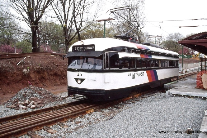 PCC 23 is outbound at Franklin Avenue, it will soon go around the loop track and become inbound (to Penn Station). The construction work in preparation of the new LRV cars is in evidence along the right of way here.