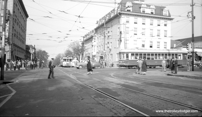 "From this scene, it would appear that a Liberty Bell Limited lightweight is backing up to the LVT downtown terminal in Allentown. Meanwhile, LVT city streetcar 900 passes by. Don's Rail Photos says, ""900 was built by Brill Car Co in February 1917, (order) #20206. It was (later) rebuilt."" Looks like an LVT employee is crossing the street."
