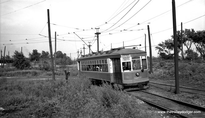 "CTA 3207 is signed for the 93rd-95th route on June 27, 1948. This was early in the CTA era, and this car does not appear to have either a CTA or CSL logo on its side. M. E. writes, ""CTA 3207 is signed for the 93rd-95th route on June 27, 1948."" The railroad on the right is the east-west line (I believe the Rock Island) that ran at about 94th Place. If this picture had been taken about a block behind the current camera location, it would show the north-south railroad that crosses the east-west railroad. So this view faces east and is situated at about 94th Place and a block west of Stony Island Ave. The streetcar is heading west. The 93rd-95th line wiggled a bit in this area. It went west on 93rd St. to Stony Island Ave., south on Stony Island to about 94th St., west a half-block or so, south another half-block (the streetcar trackage at the left of the picture), then west alongside the east-west railroad. It is this last-mentioned turn that is photographed."" Andre Kristopans: ""Regarding the PROW west of Stony Island – there are THREE railroads to the right – nearest is the Belt Ry of Chicago, furthest is the Rock Island, both heading for South Chicago, and coming into the middle from the right is the Chicago & Western Indiana from State Line. The CWI crossed the RI and the Nickel Plate (New York Chicago & St Louis) which headed north towards the NYC at 75th St at what was called Pullman Junction. Also, the reason for the PROW was because before Calumet Yard was built by the Nickel Plate about 1950, their yard was between 83rd and 93rd, and thus 93rd St was never put thru."""