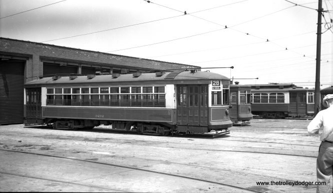 "CTA 3262, signed for route 28, is at the Vincennes Avenue shops on July 4, 1949. (Charles K. Willhoft Photo) This picture may have been taken during an ERA fantrip. One of our readers opines, ""Burnside Station at 93rd & Drexel (possibly)."""