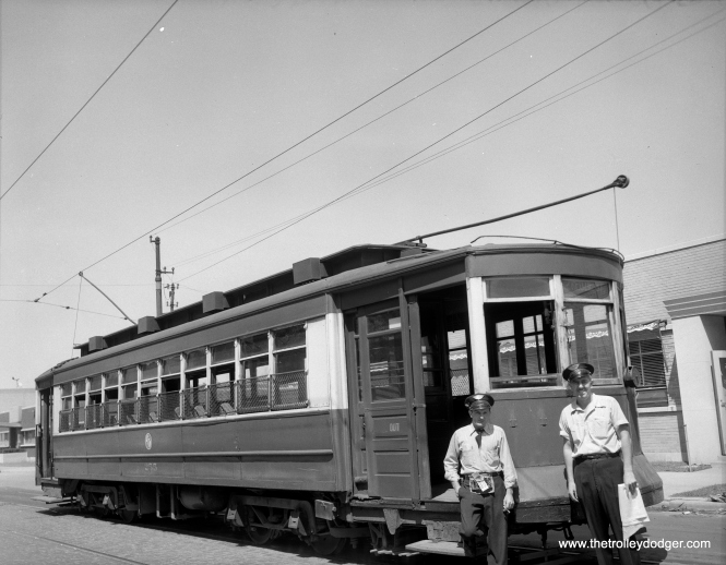 CTA 255 on Route 52 - Kedzie-California, with its two-man crew on July 23, 1953, at California-Roscoe.