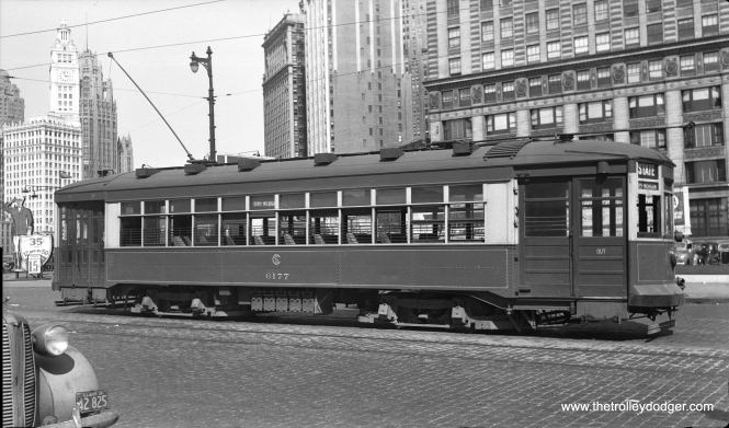 "CSL 6177 southbound at State and Wacker on July 26, 1939. George Trapp: ""Photo of car 6177 on State just south of Wacker, car is empty and is probably laying over as it's on the northbound track. After closure of old State Street bridge it was a good place for short turn State Downtown cars to lay over. Side sign says State-Michigan."""
