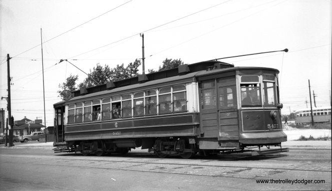 "CTA 5457 at 79th and Western on May 29, 1949. Note the PCC in the nearby loop at rear. M. E. writes, ""The PCC loop was at the south end of the Western Ave. streetcar line. The loop itself was on the east side of Western at about 78th Place. Car 5457 is at the end of the westbound track on 79th St. east of Western. The trolley has been reversed and the car is ready to head back east on 79th St. To the left of car 5457 is the intersection of 79th and Western."""