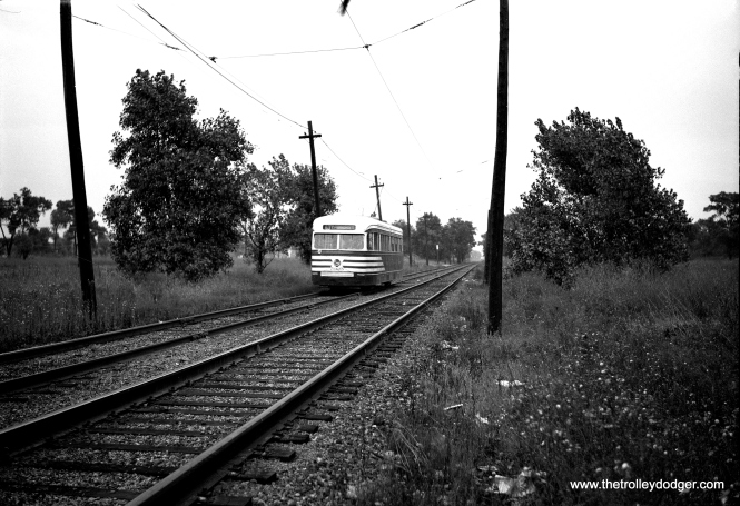 PCC 7023 heads west on the mile-long private right-of-way at the west end of the 63rd Street line. This is a built-up residential neighborhood today.