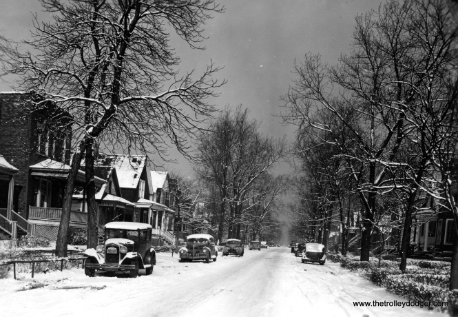 "In 1946, my grandparents on my mother's side bought a wooden frame house at 6226 South Honore Street in Chicago. Previously, they had lived in Lakeview on Newport starting in 1937. This is what their block on Honore looked like in 1946. The jalopy at left, which looks like a Model A Ford, was their car and must have been the oldest one on the block. The house remained in the family until the early 1970s when my uncle sold it. It has since been demolished, as have most of the other homes on this block. They lived just north of 63rd Street, which had a busy streetcar line, and less than a mile away from Loomis, west end of the Englewood branch of the south side ""L"". In 1969 the ""L"" was extended west a few blocks to Ashland, a more logical place to transfer to buses."