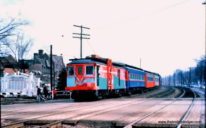 "This must be the March 24, 1962 train taking CA&E equipment purchased by RELIC, the predecessor to the Fox River Trolley Museum. According to Don's Rail Photos, ""11 was built by Brill in 1910, (order) #16483. It was rebuilt to a line car in 1947 and replaced 45. It was acquired by Railway Equipment Leasing & Investment Co in 1962 and came to Fox River Trolley Museum in 1984. It was lettered as Fox River & Eastern."" This picture was taken in Glen Ellyn along the C&NW. (Mark Llanuza Collection)"