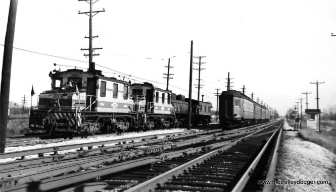 "CA&E freight and passenger trains in Elmhurst in this November 5, 1949 view. (Gordon E. Lloyd Photo) Bill Shapotkin: ""This pic is just east of Mannhiem Rd. The frt locos are on the CA&E/IHB interchange. While technically near Butterfield Rd, it is nowhere near Roosevelt Rd."" (Roosevelt and Butterfield was written on the back of the photo, apparently in error. This was not uncommon when the photographer was from out of town.)"