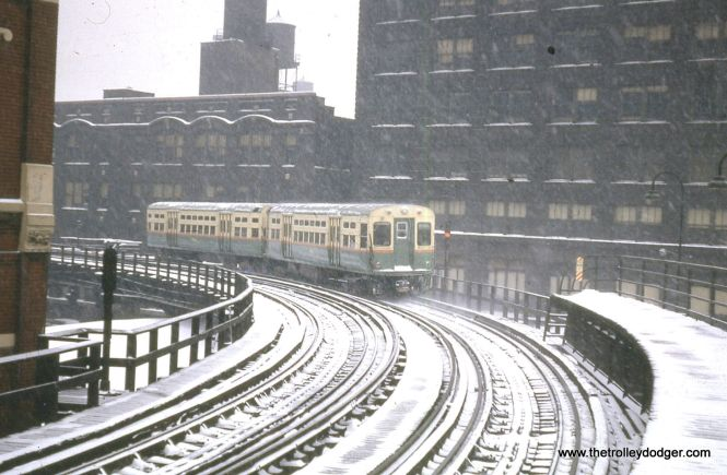 A pair of CTA 6000s head north from the Merchandise Mart in this wintry 1963 scene.