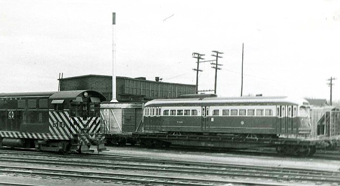 "Here is a postwar Chicago PCC streetcar in the Streator Yard of the Santa Fe, on its way to St. Louis Car Company as part of the CTA's ""conversion program."" (Phil Becker Photo)"