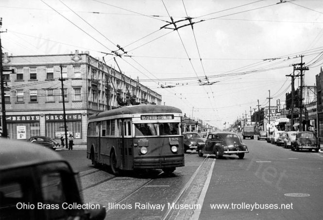 CSL Brill 188 is southbound on Central Ave at North Ave, with a westbound streetcar in the background on North Ave. You can see that trolley buses shared wire on North with streetcars-- an unusual occurrence in Chicago, although it was common in other cities. Photo courtesy the Illinois Railway Museum Strahorn Library and the Scalzo collection, caption help courtesy of Roy Benedict.)