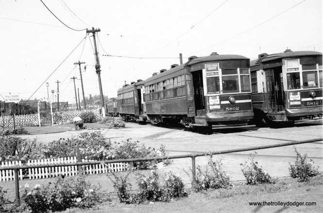 "CTA 5802 in August 1948 at one of the Stations (car houses) serving the Cottage Grove line. As you can see, at one time CSL (and CTA) were very much interested in landscaping and beautification. (Carl Hehl Photo) Bob Lalich: ""CTA 5802 in August 1948 was taken at the Burnside car barn. The IC tracks can be seen in the background. There was an article about the Burnside car barn gardens in First & Fastest a couple of years ago."" Andre Kristopans adds, ""definitely the back yard at Burnside."""