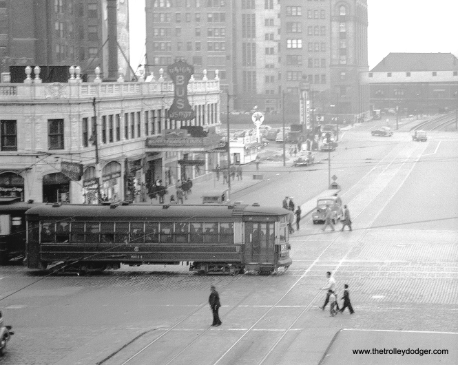 CSL 5814 (route 4 - Cottage Grove) is southbound on Wabash at Roosevelt Road on June 13, 1947. At rear, you can see where the Roosevelt Road streetcar line was extended to the Museum Loop for the 1933-34 world's fair (A Century of Progress). (J. William Vigrass Photo)