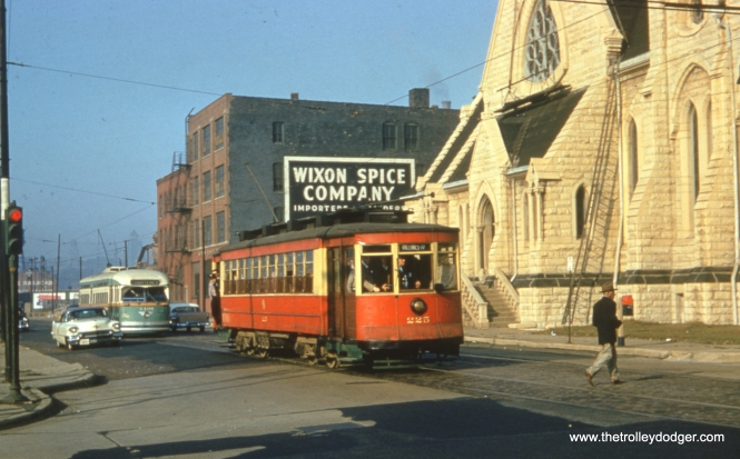 "The date is October 21, 1956, and the occasion is a weekend fantrip using red Pullman 225 and postwar PCC 4406. We have posted other photos from this fantrip before. By this time, Chicago only had two streetcar lines left, and they only operated on weekdays. Car 225 is one of three Pullmans that were saved, and it is now at the Seashore Trolley Museum in Maine. Bob Lalich adds, ""The photo of red Pullman 225 on a fan trip was taken at 18th and Clark. The car is SB."" The church was called Old St. John's, and was demolished around 1962."