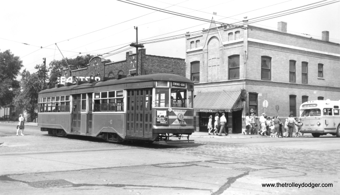 "CSL Sedan 6317 at 10559 South Ewing. That bus at right is on the 103rd Street route. That's the old Eastside Theater behind the streetcar. According to Cinema Treasures, ""The Eastside Theater opened in 1922, at Ewing Avenue between 105th Street and 106th Street, in the East Side neighborhood of Chicago, not far from the Illinois-Indiana border. The Eastside Theater closed in 1951. Today, a bank is located on the site of the Eastside Theater, in a building dating from the late-1970's."" (Joe L. Diaz Photo)"