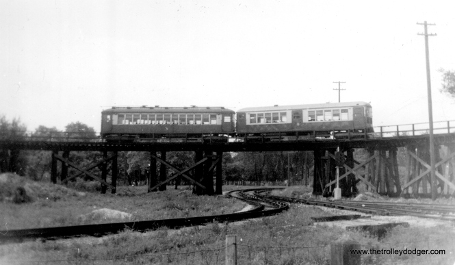 """CTA elevated train on loop over Aurora-Elgin track (Garfield Park line, Des Plaines Ave.), August 1955."" (Roy Bruce Photo)"