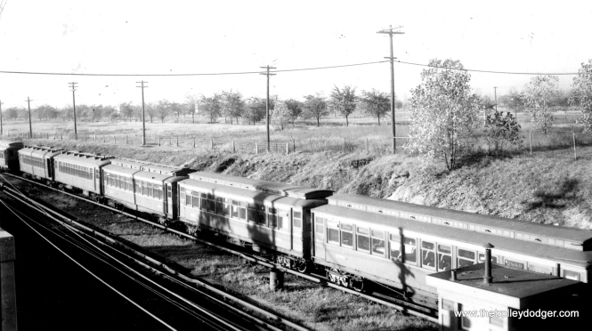 This would appear to be a lineup of rapid transit cars in storage at Roosevelt Road on the Westchester branch, which was owned by CA&E. It was intended to be part of a bypass route that would have gone through what we know today as Oakbrook. Service on this branch ended in December 1951. The only car number I can make out in this photo is 2889. (Dick Rumbolz Photo)