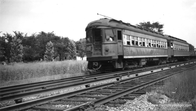 "A two-car CA&E train, headed up by 434, ""at speed."" Not sure of the exact location. (H. L. Younger Photo)"