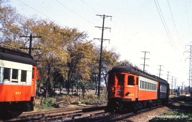 CA&E 423 and 433 have just passed each other just west of the Forest Park terminal at DesPlaines Avenue in October 1953. Concordia cemetery is to the left. This is now the site of I-290.