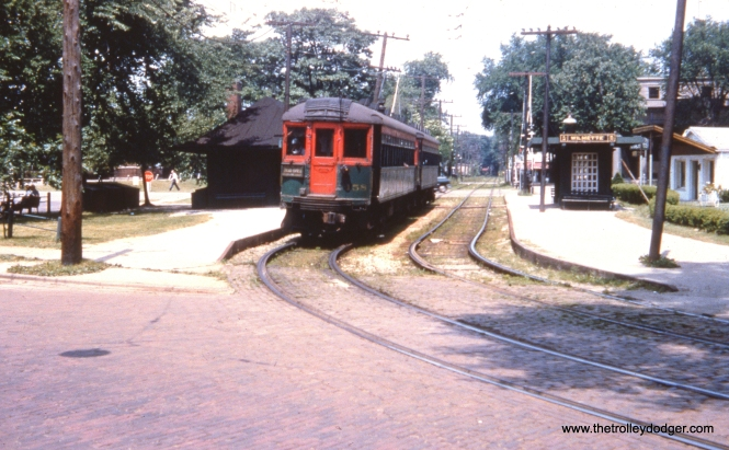 The view looking south towards the Wilmette station on the CNS&M Shore Line Route, which was abandoned in 1955. For a view from the other end of the same station, look here. Northbound trains began street running on Greenleaf Avenue here.
