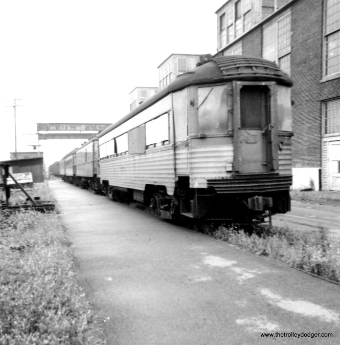 "This 1968 photo presents a bit of a mystery. The only other North Shore car owned by the American Museum of Electricity was 710, sold along with the 162 to the Connecticut Trolley Museum in 1971. But there are other cars shown in this line-up, and the partial number for this one looks like it's in the 750-series. Stephen B. Rudolph adds, ""I just dug up an identical print of the photo of the boarded-up CNS&M 755. The back of my print is machine-dated by the photofinisher ""JUNE 64."" This wasn't somebody's rubber date stamper, so I think it's correct. Consequently, I believe the 1968 date stated above is incorrect."""