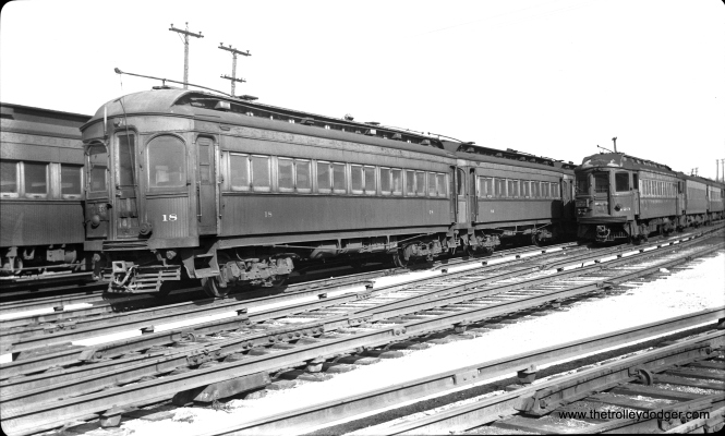 "Don's Rail Photos says CA&E 18 was ""built by Niles Car in 1902. It was modernized in March 1941 and retired in 1955."" Here it is at Wheaton on March 15, 1952."