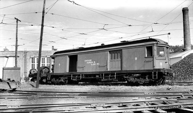 "Don's Rail Photos says CA&E merchandise express car 9 was ""built by Niles Car in 1907. It was scrapped in 1959."" It is shown here at Wheaton in August 1948."