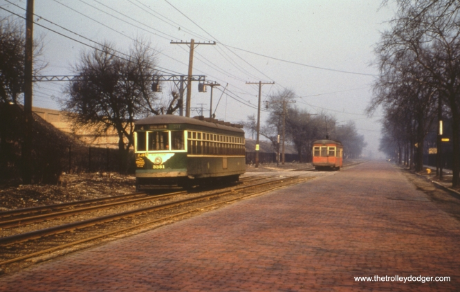 "CTA 3381, now in CTA green, near the south end of route 4 - Cottage Grove, circa 1952. We can tell that this car has been converted to one man because of the sign that says, ""Enter at Front."" (Earl Clark Photo)"