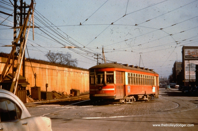 Westbound CTA 1758 is turning from Lake onto Pine in this March 1953 view. This is where Lake switched over to the other side of the Chicago & North Western embankment. The streetcar would continue on to Austin Boulevard, the city limits. That looks like a 1952 Kaiser at left.